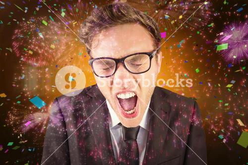 Composite image of young angry businessman shouting at camera