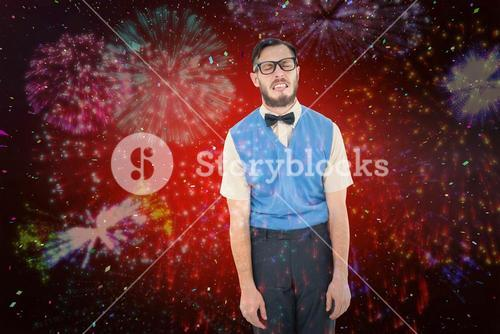 Composite image of geeky hipster pulling a silly face