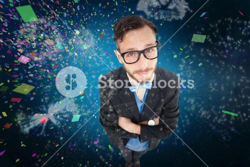 Composite image of geeky hipster looking at camera