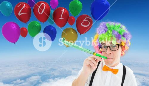 Composite image of geek blowing party horn