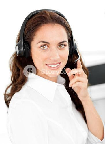 Positive woman with headset working in a call center