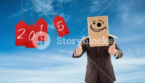 Composite image of anonymous businessman with thumbs up