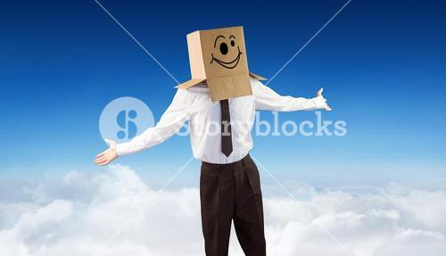 Composite image of anonymous businessman with arms out