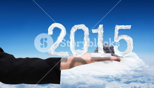 Composite image of businesswomans hand presenting