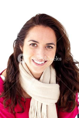 Joyful woman wearing a scarf smiling at the camera