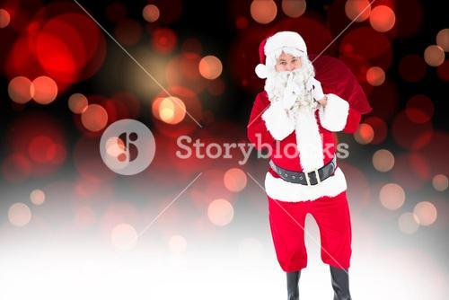 Composite image of santa holding sack and keeping a secret