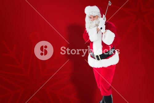 Composite image of cheerful santa claus playing golf