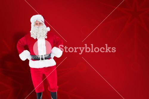 Composite image of portrait of santa claus with hands on hips