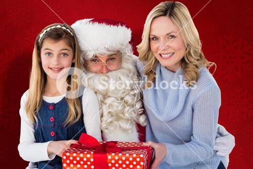 Composite image of mother and daughter with santa claus