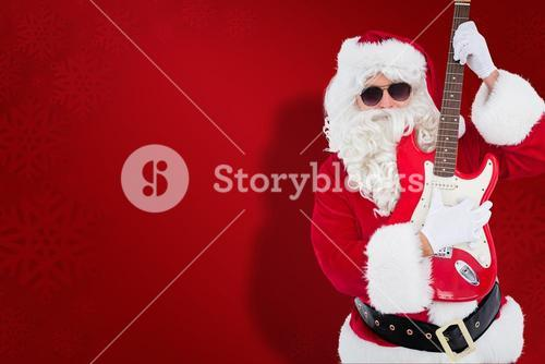 Composite image of santa with sunglasses playing electric guitar