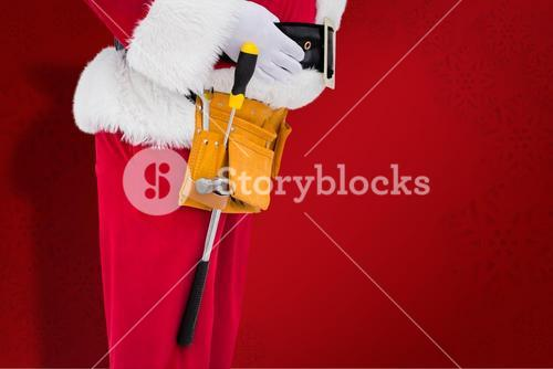 Composite image of santa claus with tool belt