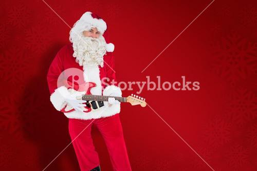 Composite image of happy santa playing electric guitar