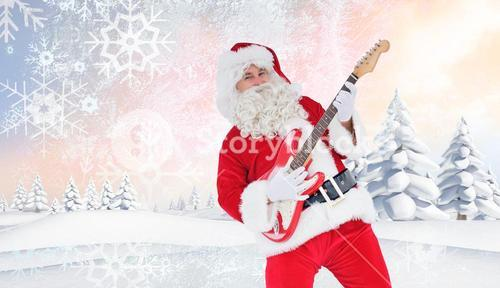 Composite image of smiling santa playing electric guitar