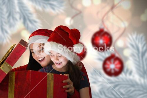 Composite image of mother and daughter opening gift