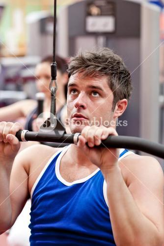 Muscular male athlete practicing bodybuilding