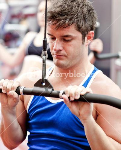 Selfassured male athlete practicing body-building