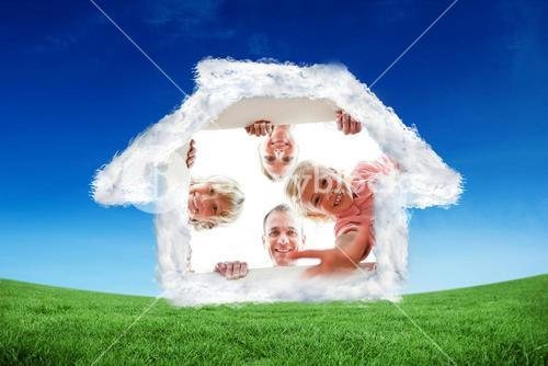 Composite image of happy family unpacking boxes