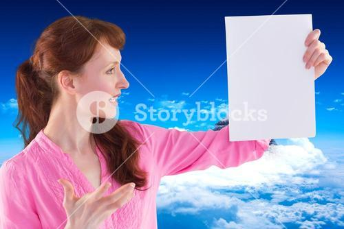 Composite image of surprised woman looking at paper