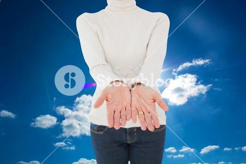 Composite image of woman standing with her hands out