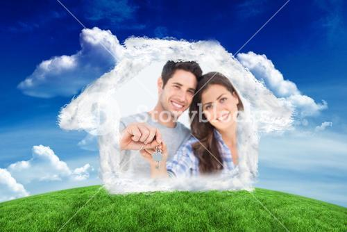 Composite image of man and wife holding a key with a house keychain