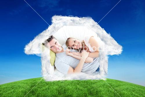 Composite image of caress young couple lying together on the sofa in the livingroom