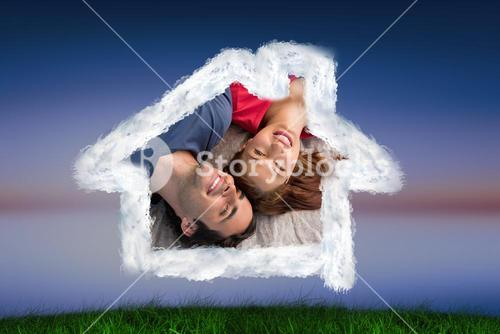 Composite image of two friends looking into the sky while lying on a quilt