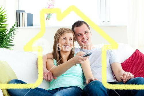 Composite image of charismatic man embracing his girlfriend while watching tv