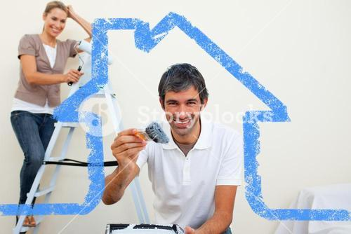 Composite image of smiling couple painting a wall