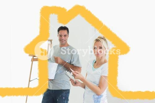 Composite image of couple with color swatches and ladder in a new house