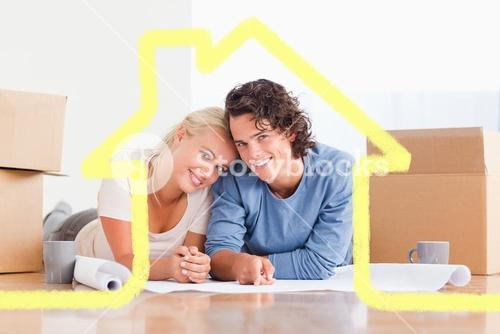 Composite image of couple organizing their future home