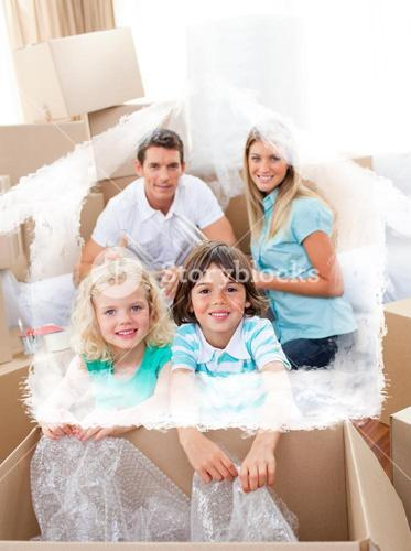 Composite image of smiling family packing boxes