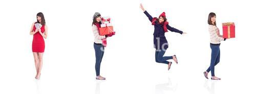 Composite image of smiling woman holding a gift