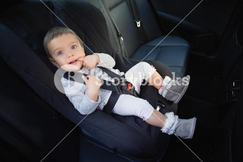 Cute baby in a car seat