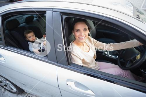 Mother with her baby in the car seat