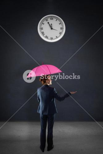 Composite image of businesswoman with umbrella