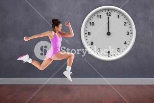 Composite image of fit brunette running