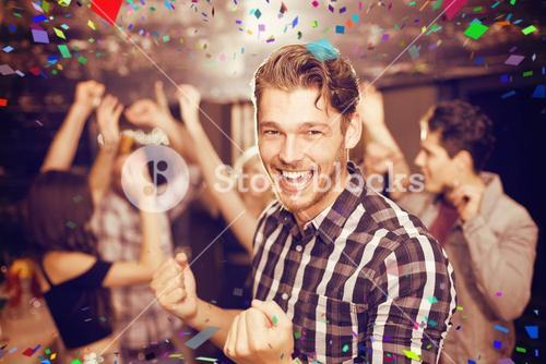 Composite image of stylish man smiling and dancing