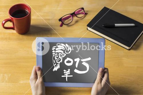 Composite image of businesswoman using tablet at desk