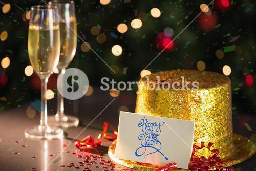 Happy new year card on table set for party