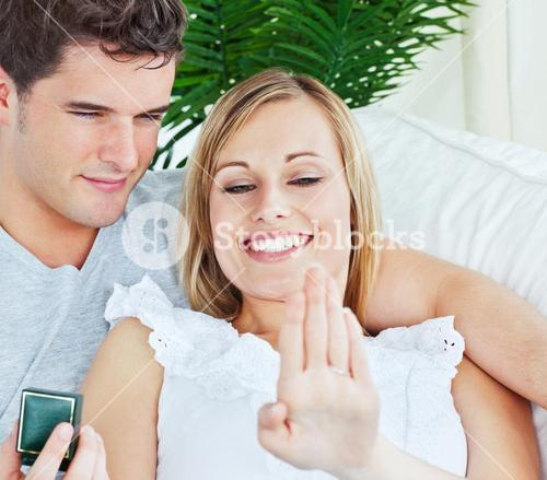 Young couple watching the ring offered by the man