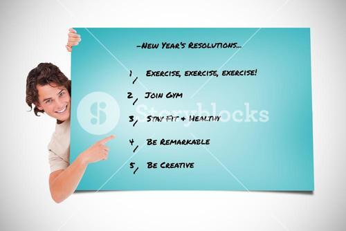 Composite image of cute guy pointing at a list looking into a camera