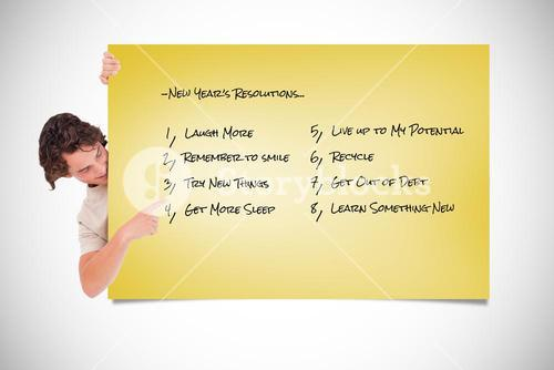 Composite image of cute guy pointing at a list
