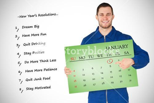 Composite image of smiling young mechanic in boiler suit pointing on calendar in his hands