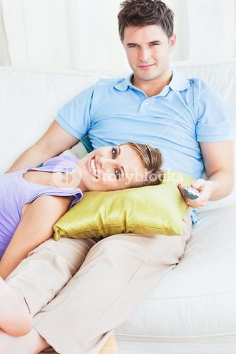 Young couple. woman lying on the mans leg