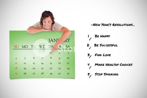 Composite image of smiling man pointing at a calendar