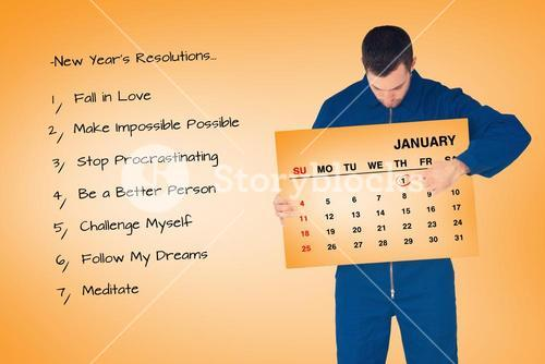 Composite image of young mechanic in boiler suit pointing on calendar in his hands