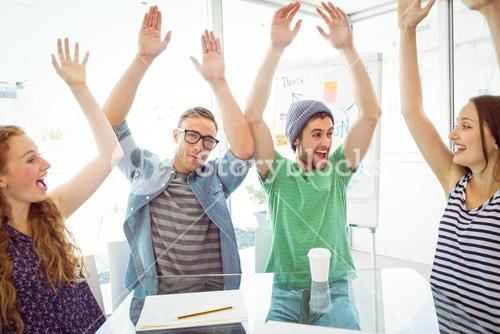 Fashion students with hands up