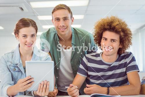 Fashion students using tablet