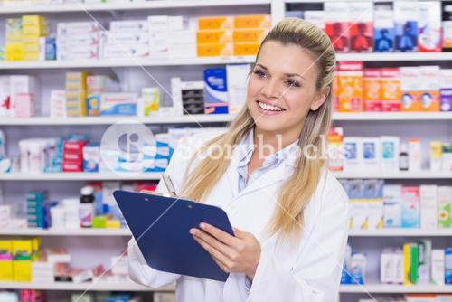 Pharmacy intern writing on clipboard