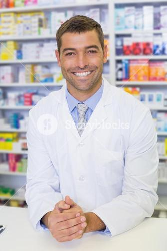 Handsome pharmacist smiling at camera